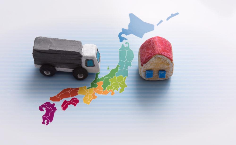 日本地図と引越しトラックの画像